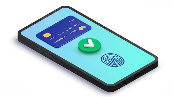 mobile phone displaying visa credit card, tick symbol and thumb print