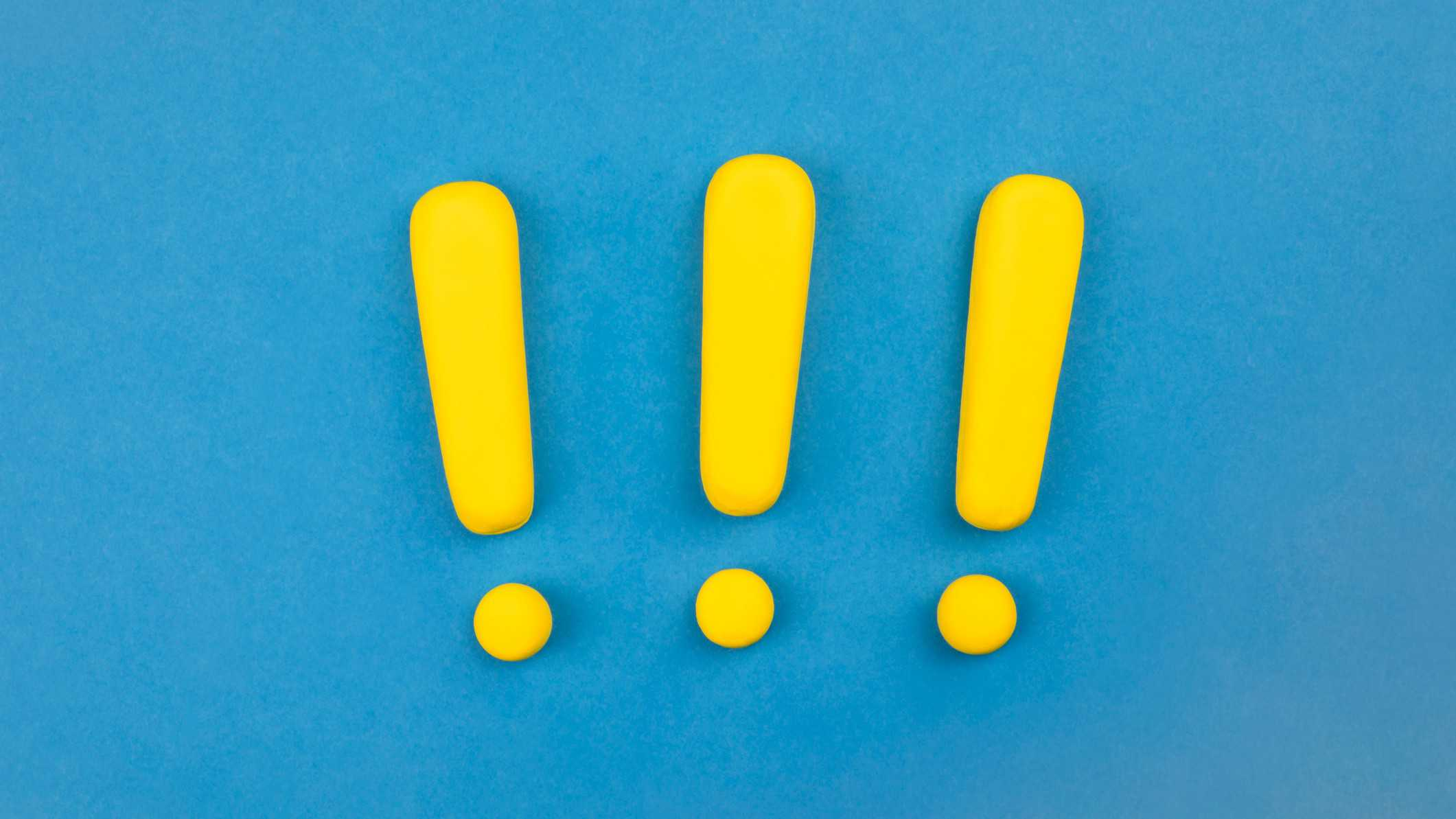 three yellow exclamation marks on blue background