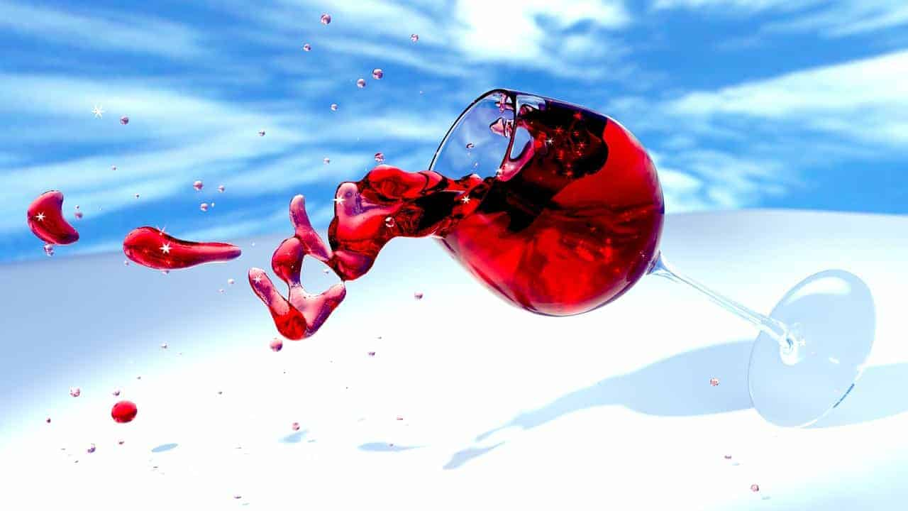 glass of red wine spilling TWE share price