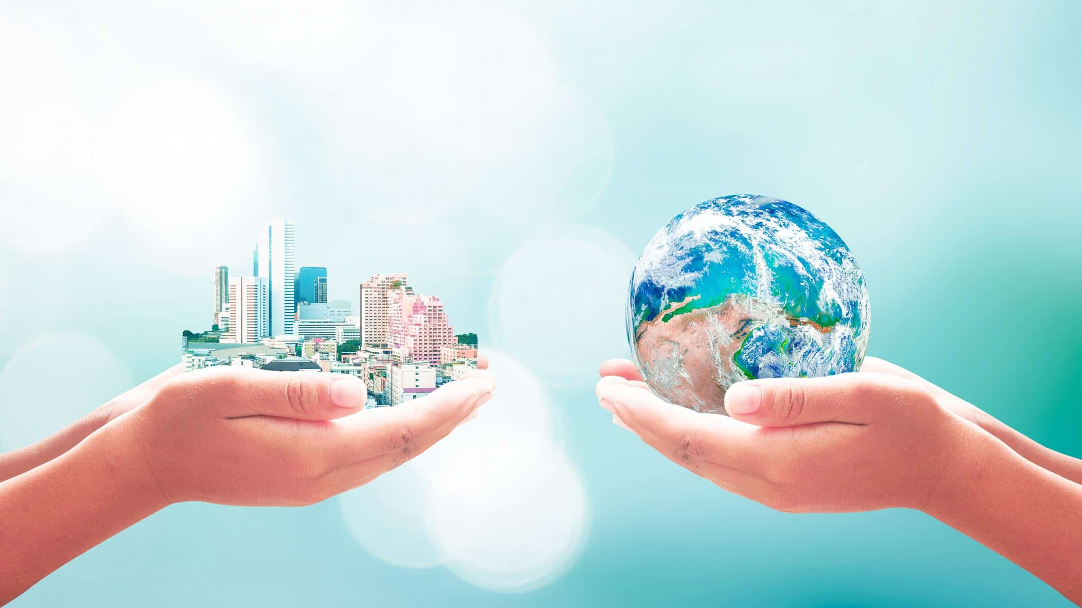 world's biggest companies represented by one person holding cityscape and another holding earth in hands