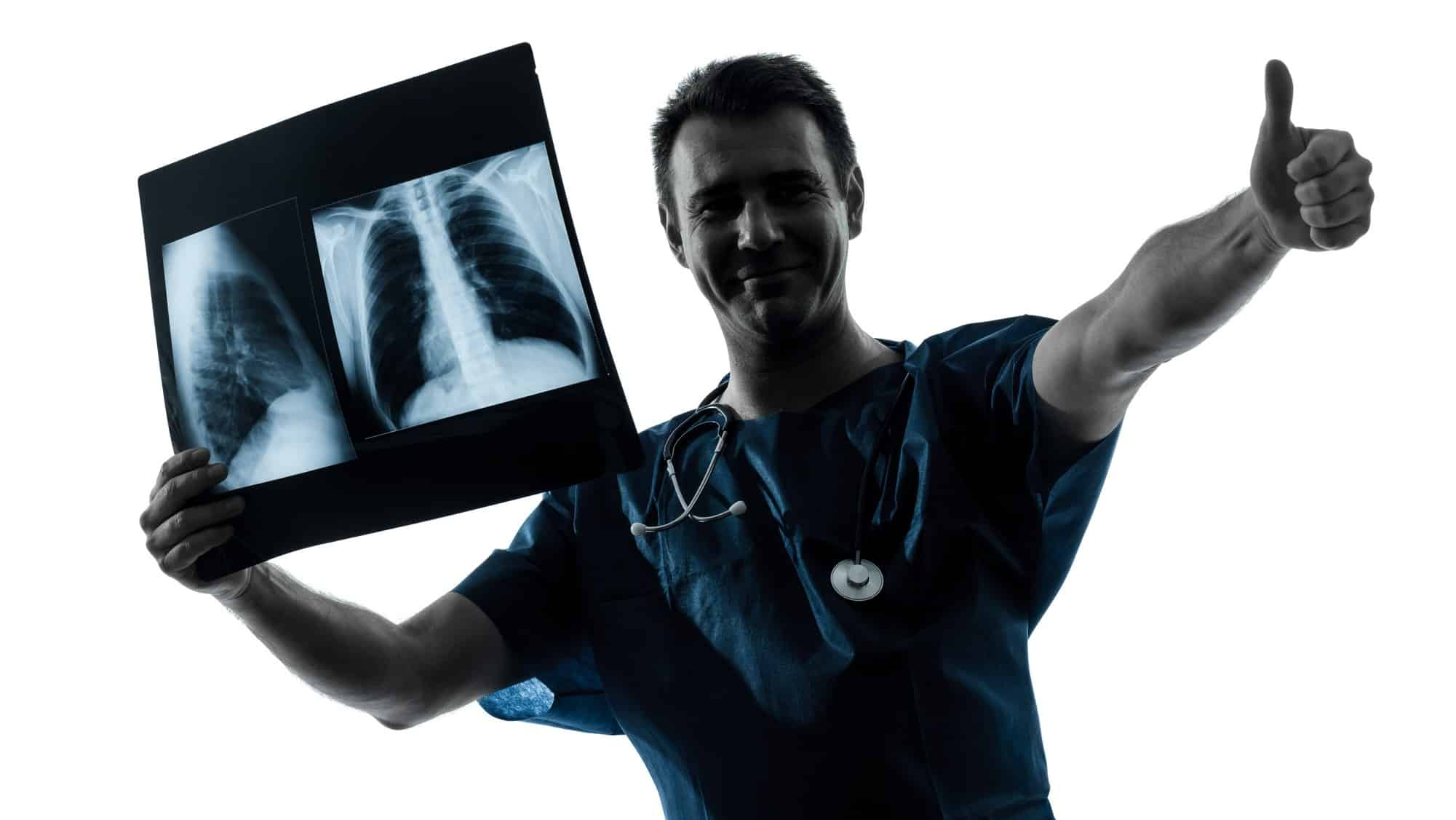 A medical specialist holding a chest an xray or scan and giving a thumbs up, indicating good results for asx healthcare share price