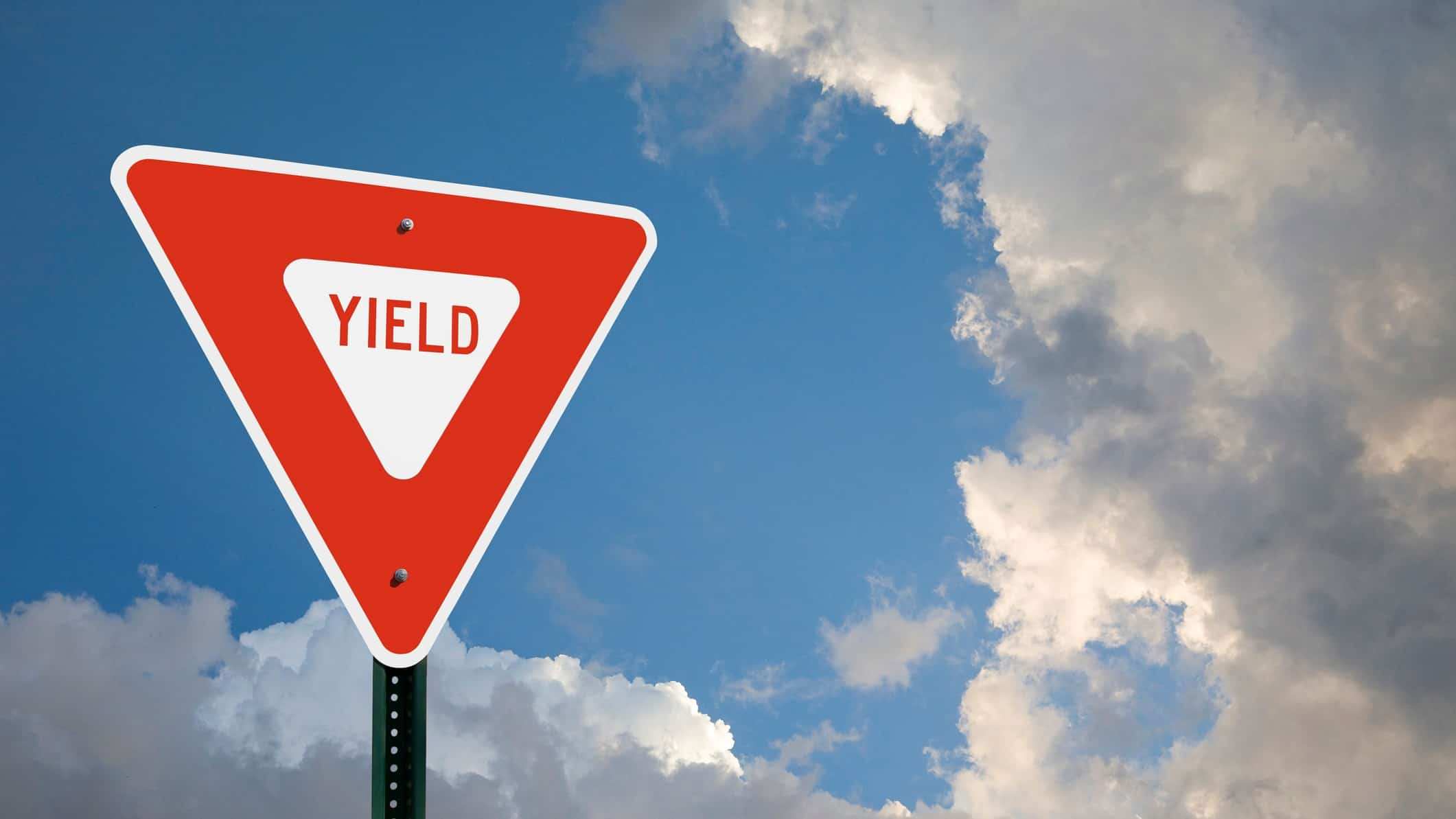 asx share price dividend yield represented by street sign saying the word yield.
