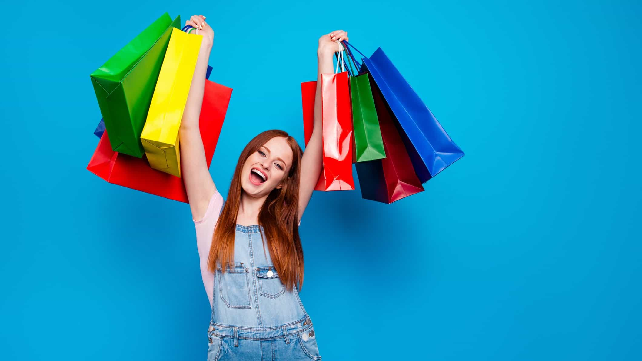 young excited woman holding shopping bags SCA profit dividend results