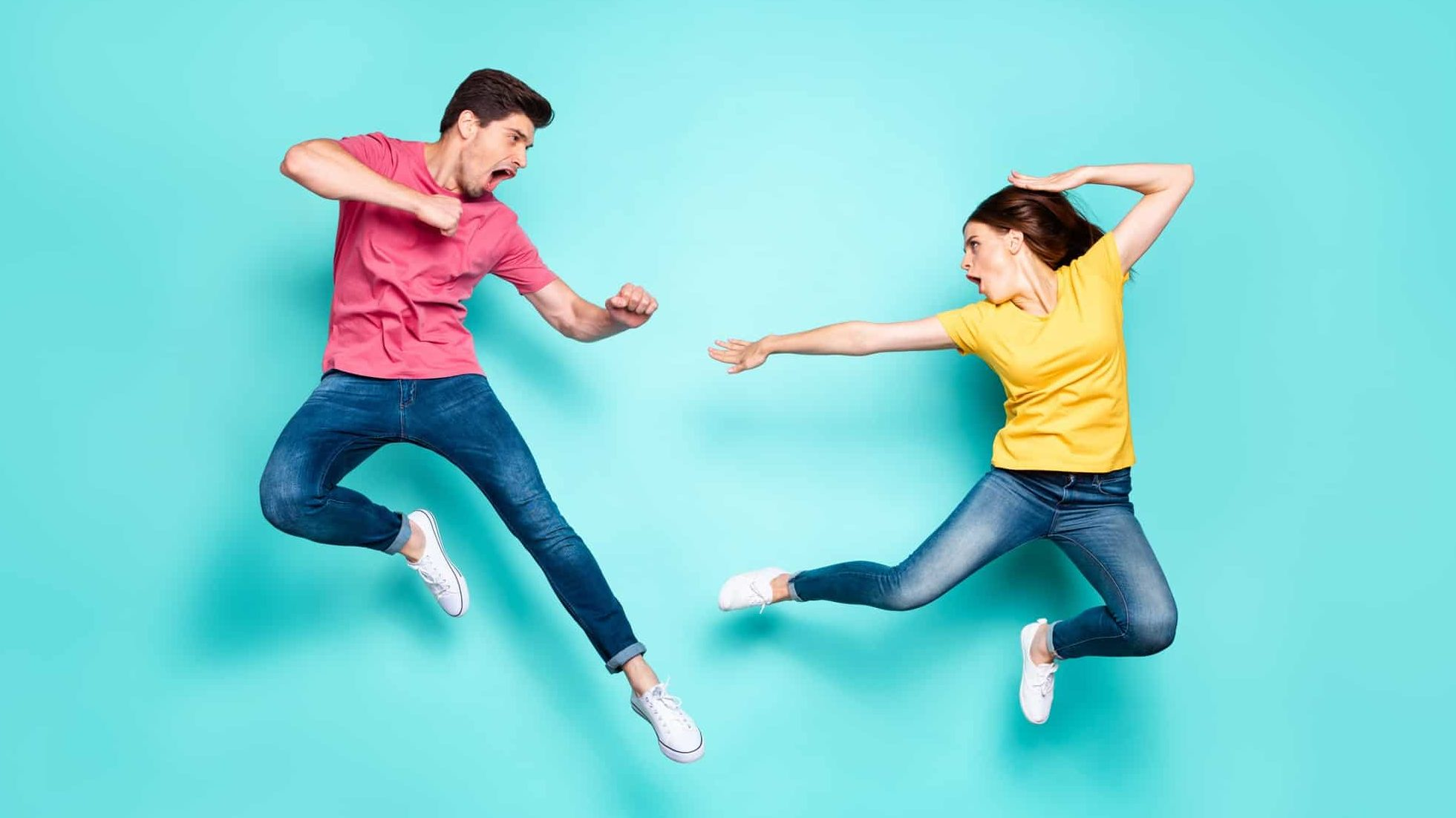 Two people jump in the air in a fighting stance, indicating a battle between rival ASX shares