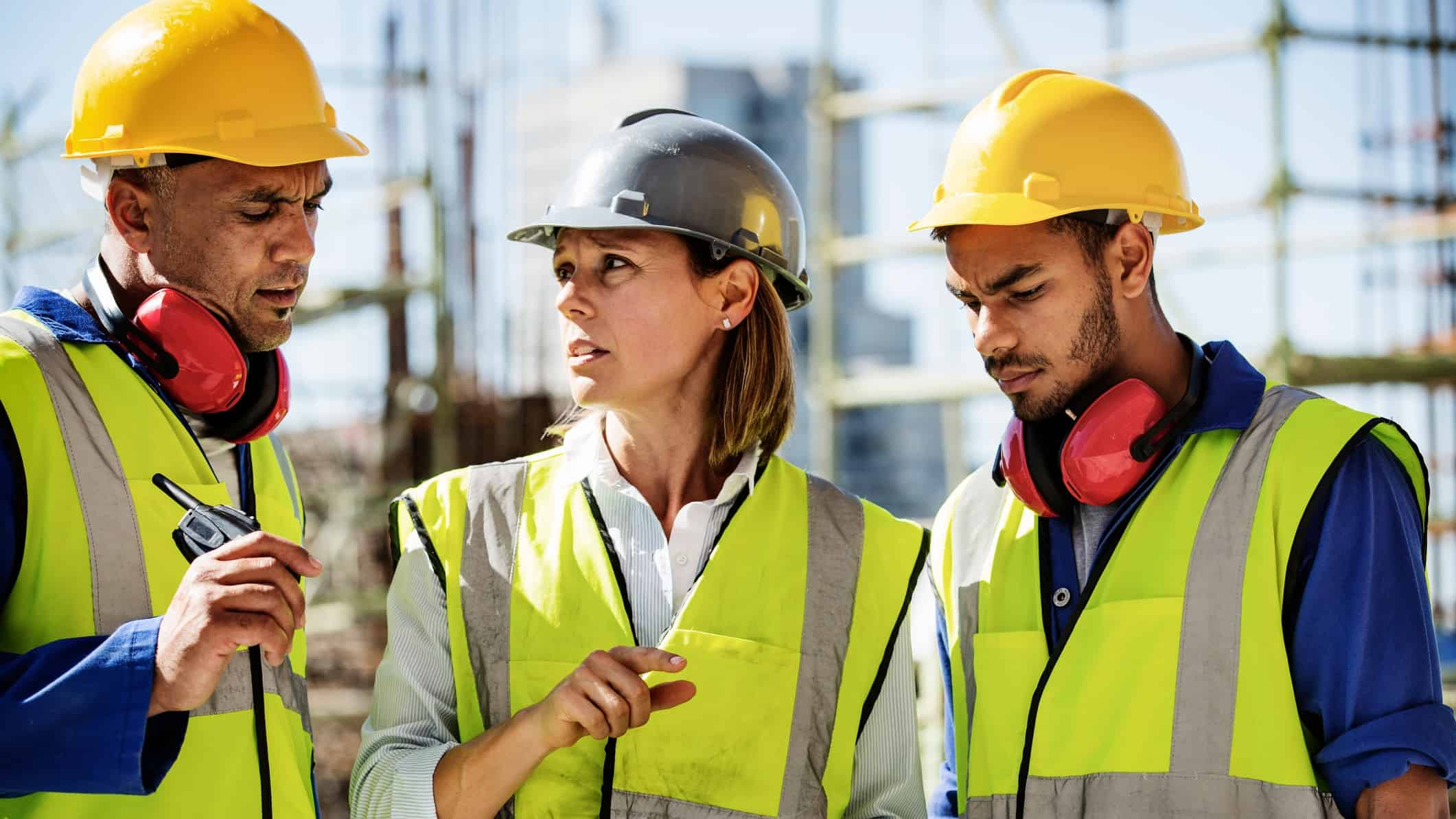 Two men and a woman in high vis gear on a Construction site