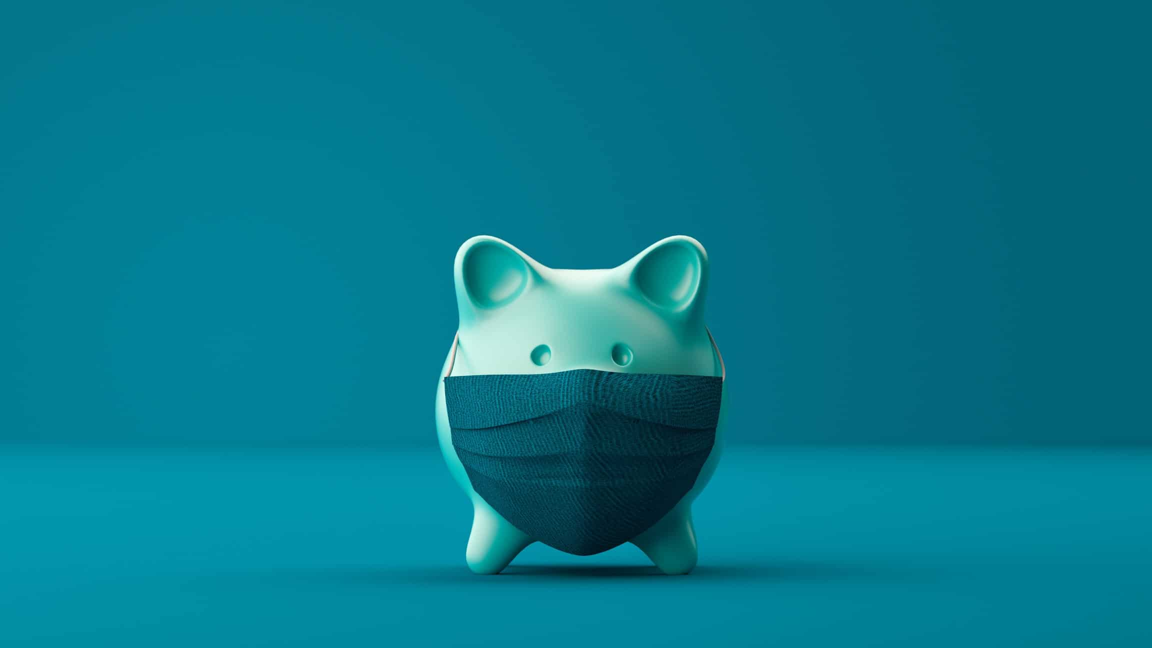 Green piggy bank with covid mask on