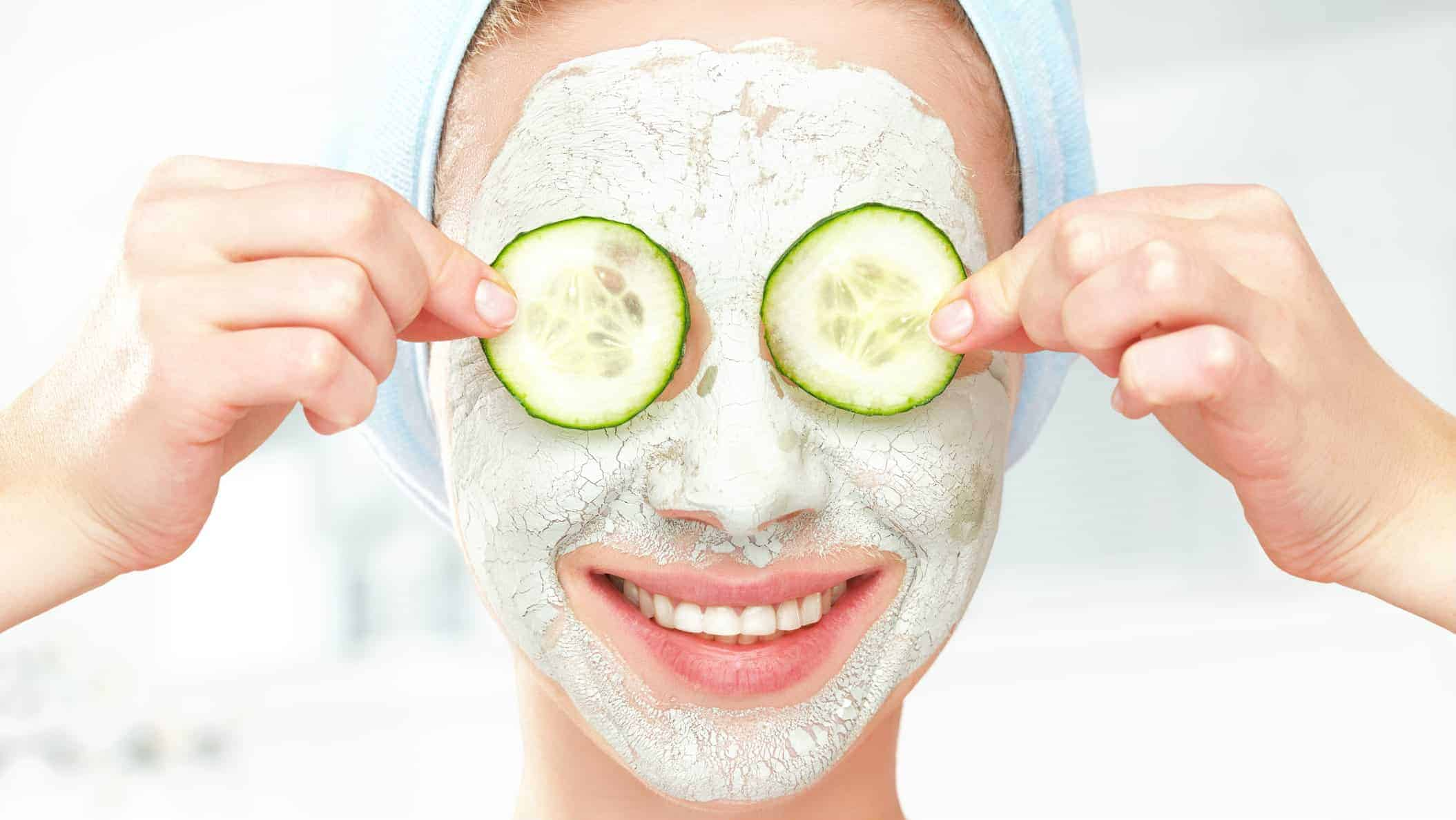 skin care asx share price represented by happy woman holding cucumbers over eyes