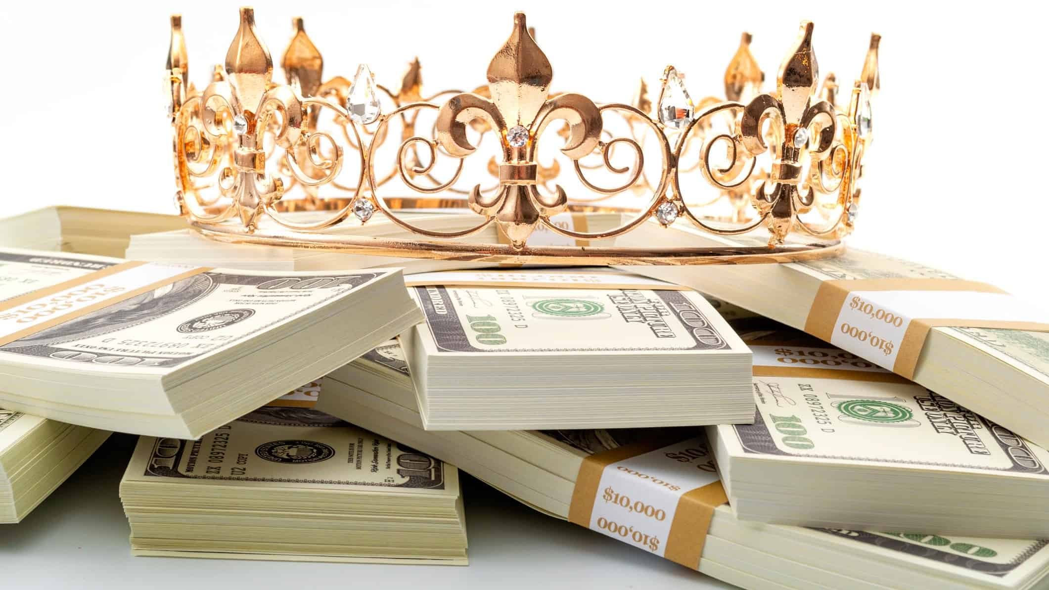 Crown sitting on top of a pile of dividend cash