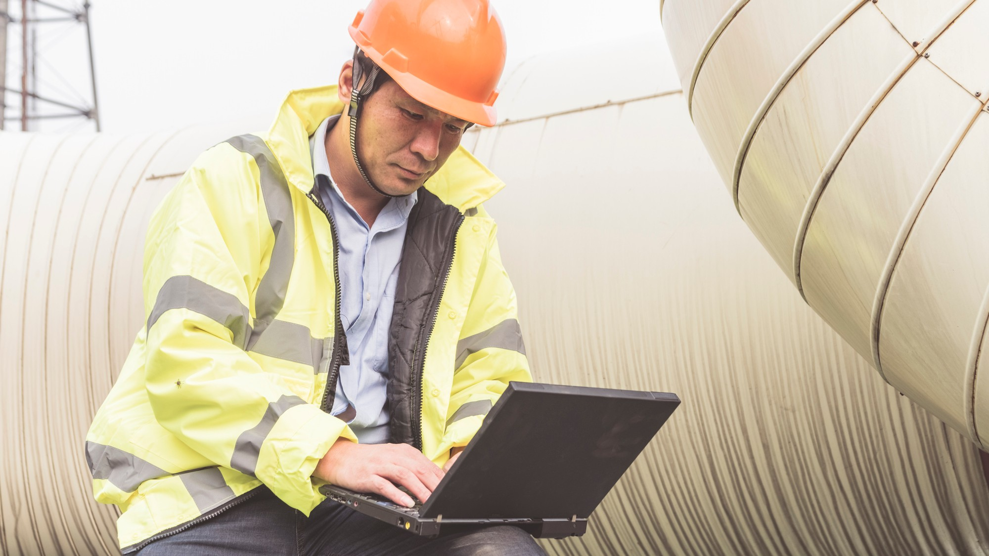 Natural gas plant engineers using laptop