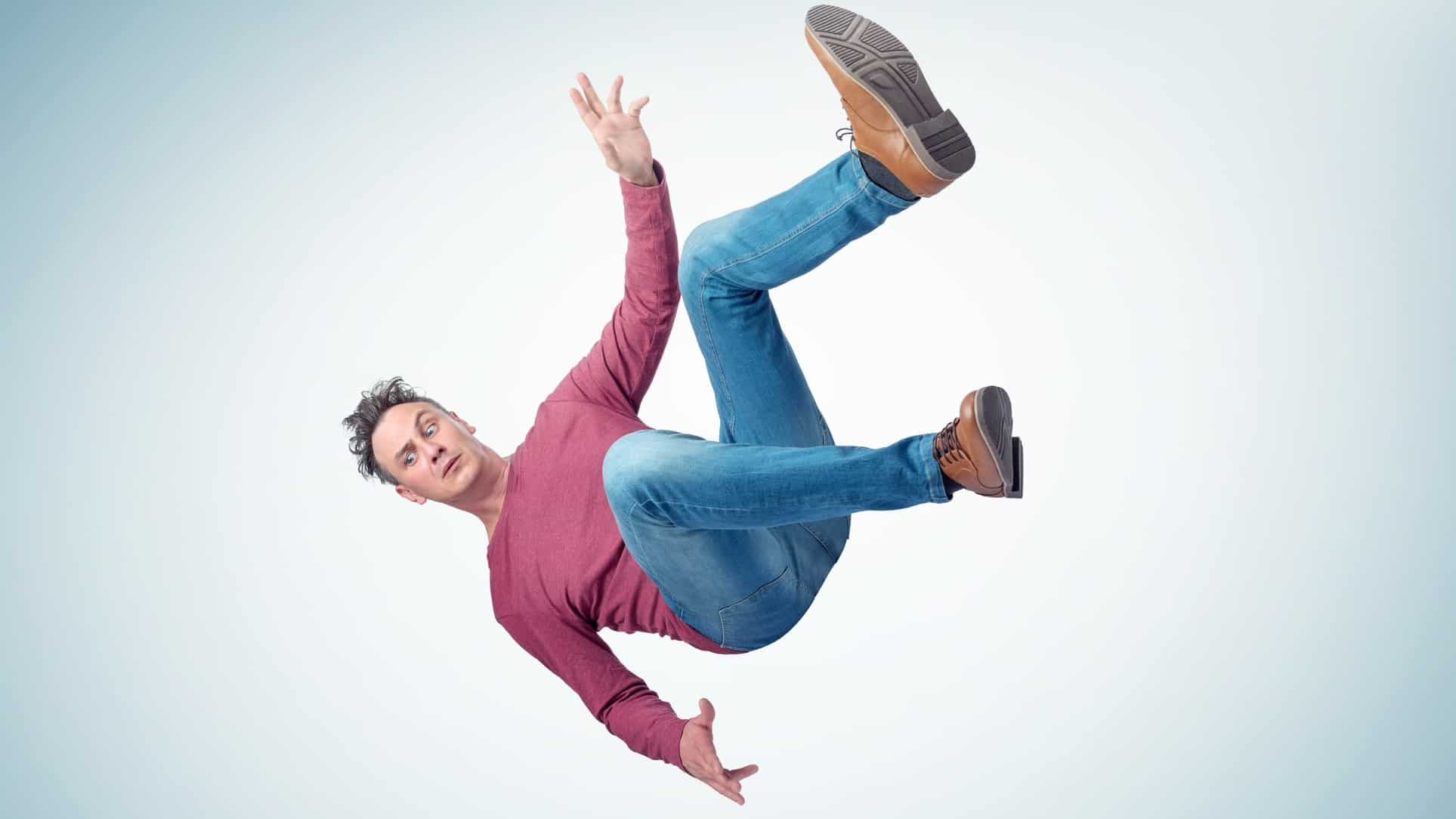 Falling ASX share price represented by man falling through the air