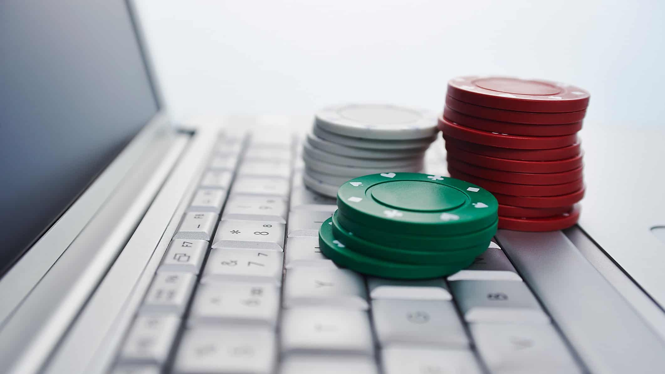 Poker chips on a laptop keyboard to symbolise gambling on ASX shares