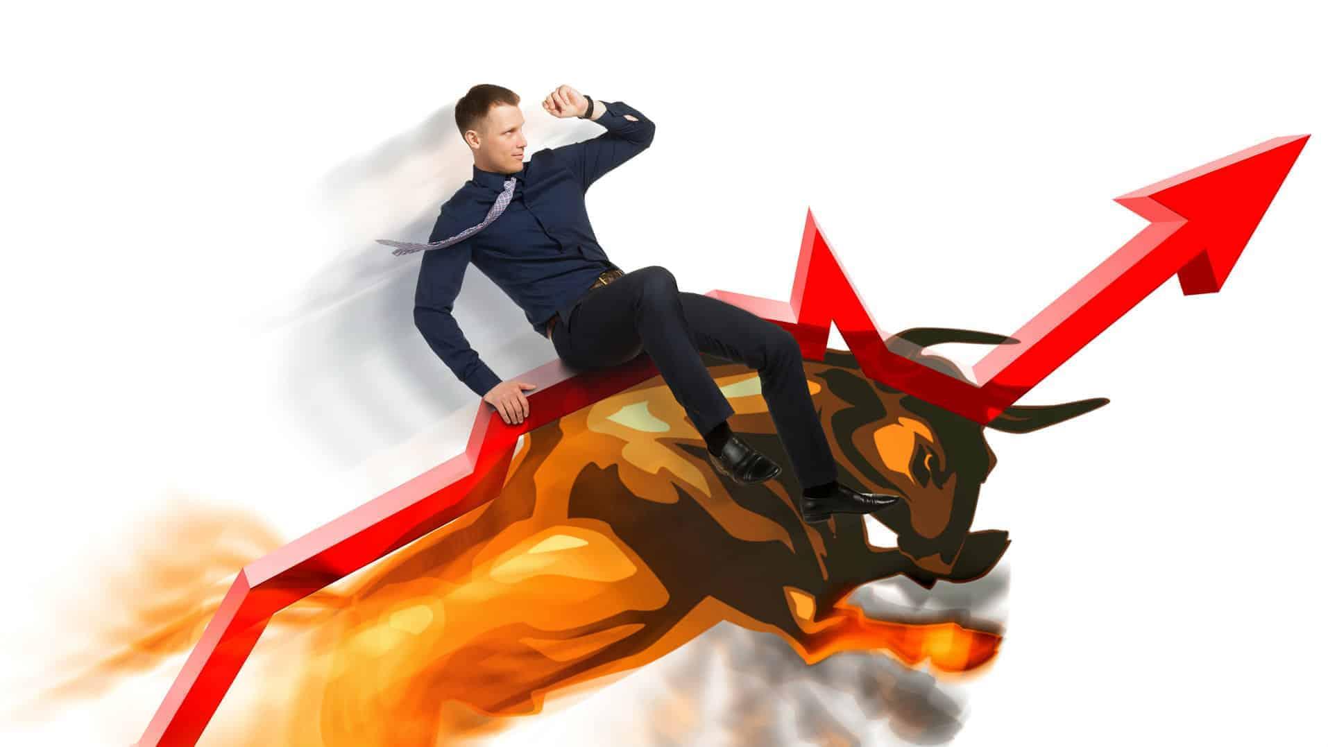 man riding bull on an upward trending arrow
