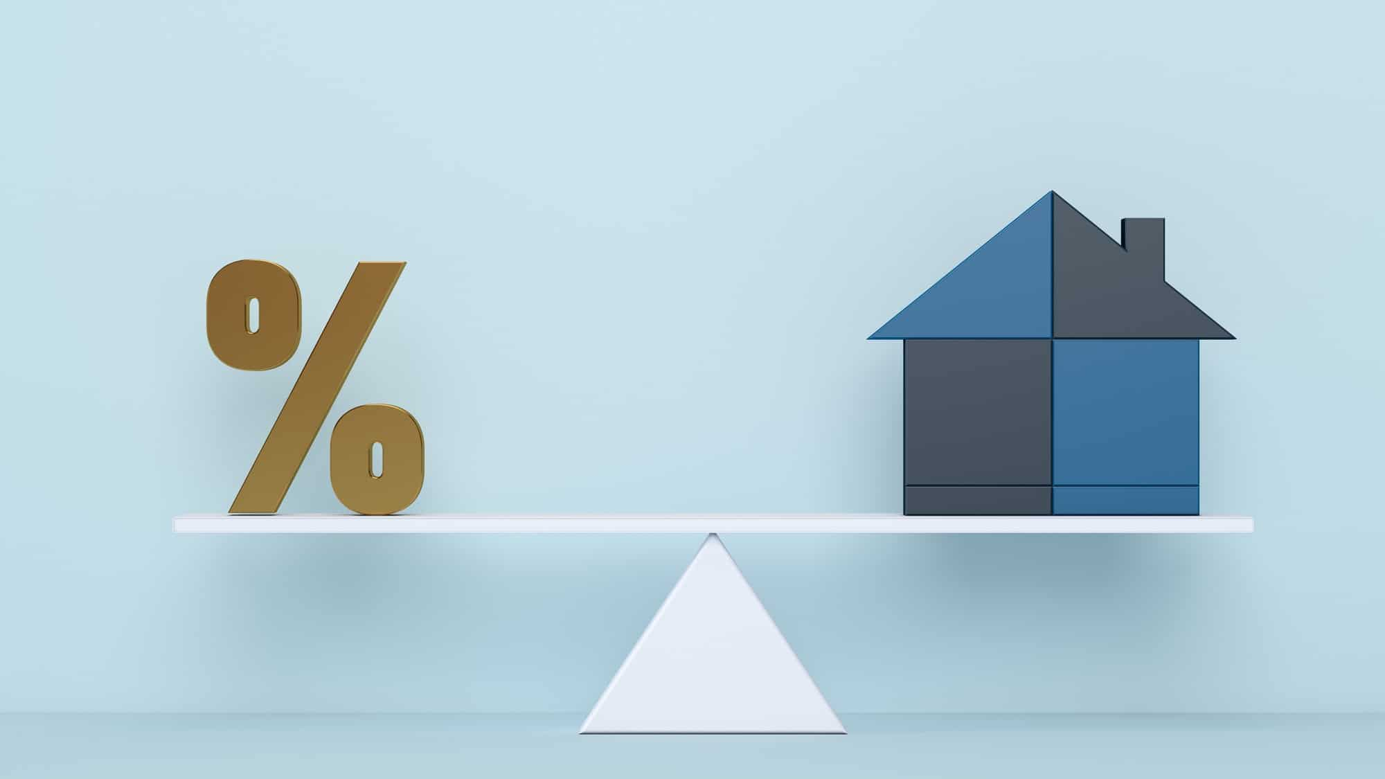 Graphic representation of a House and percentage symbol balancing on scales