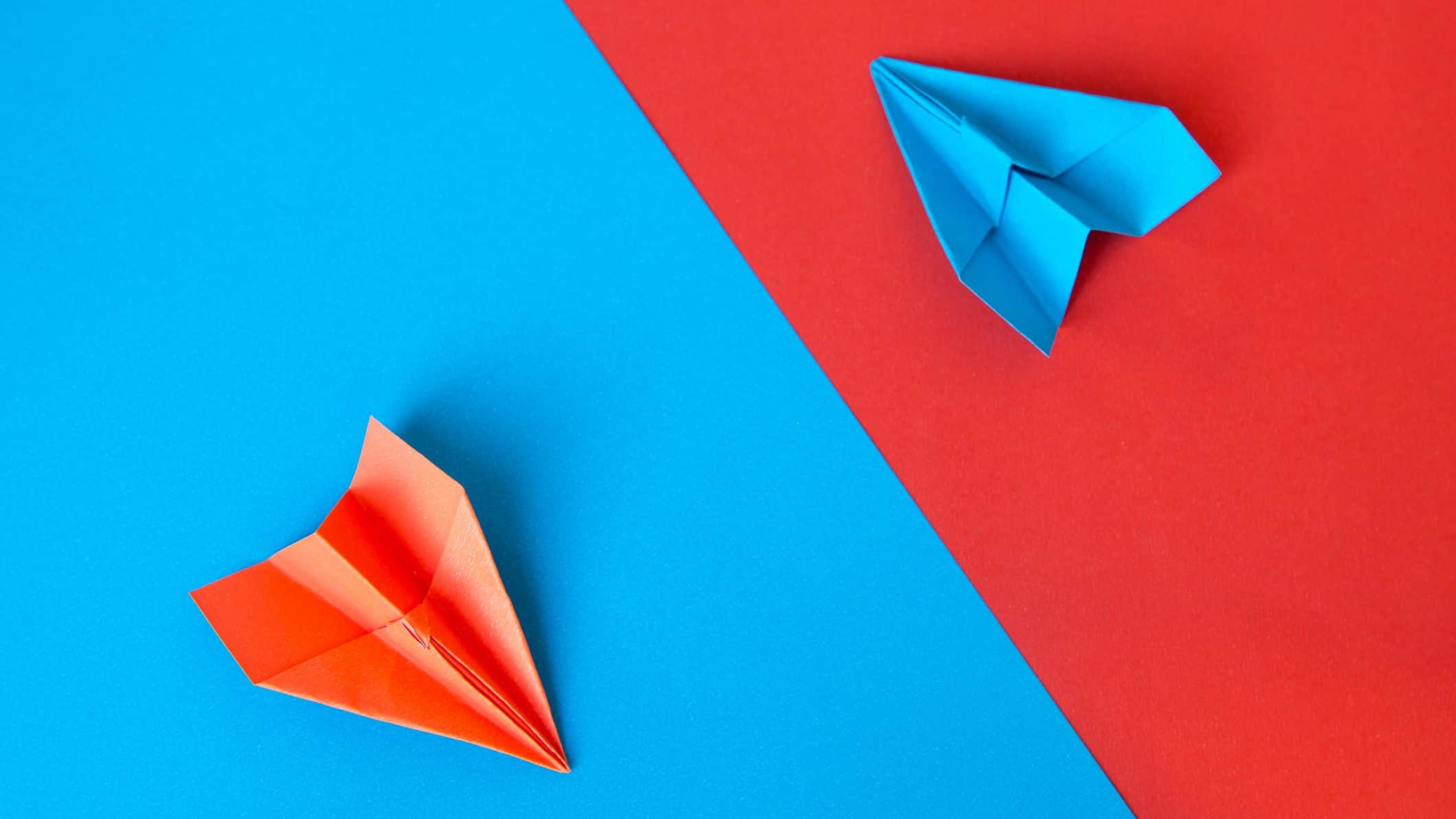 Red and blue paper planes