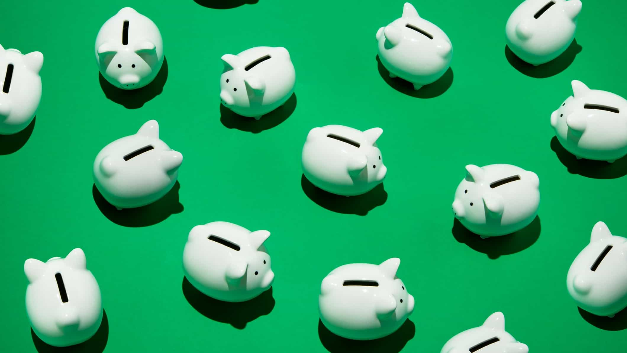 ASX bank share price represented by white Piggy Banks on green background