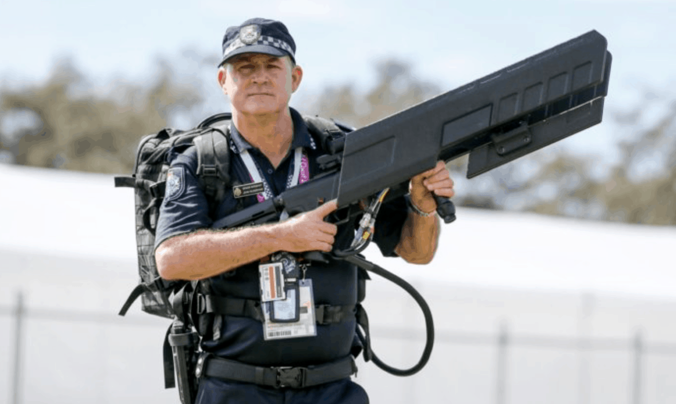 A police officer holds an Australian-made DroneGun Tactical anti-drone device