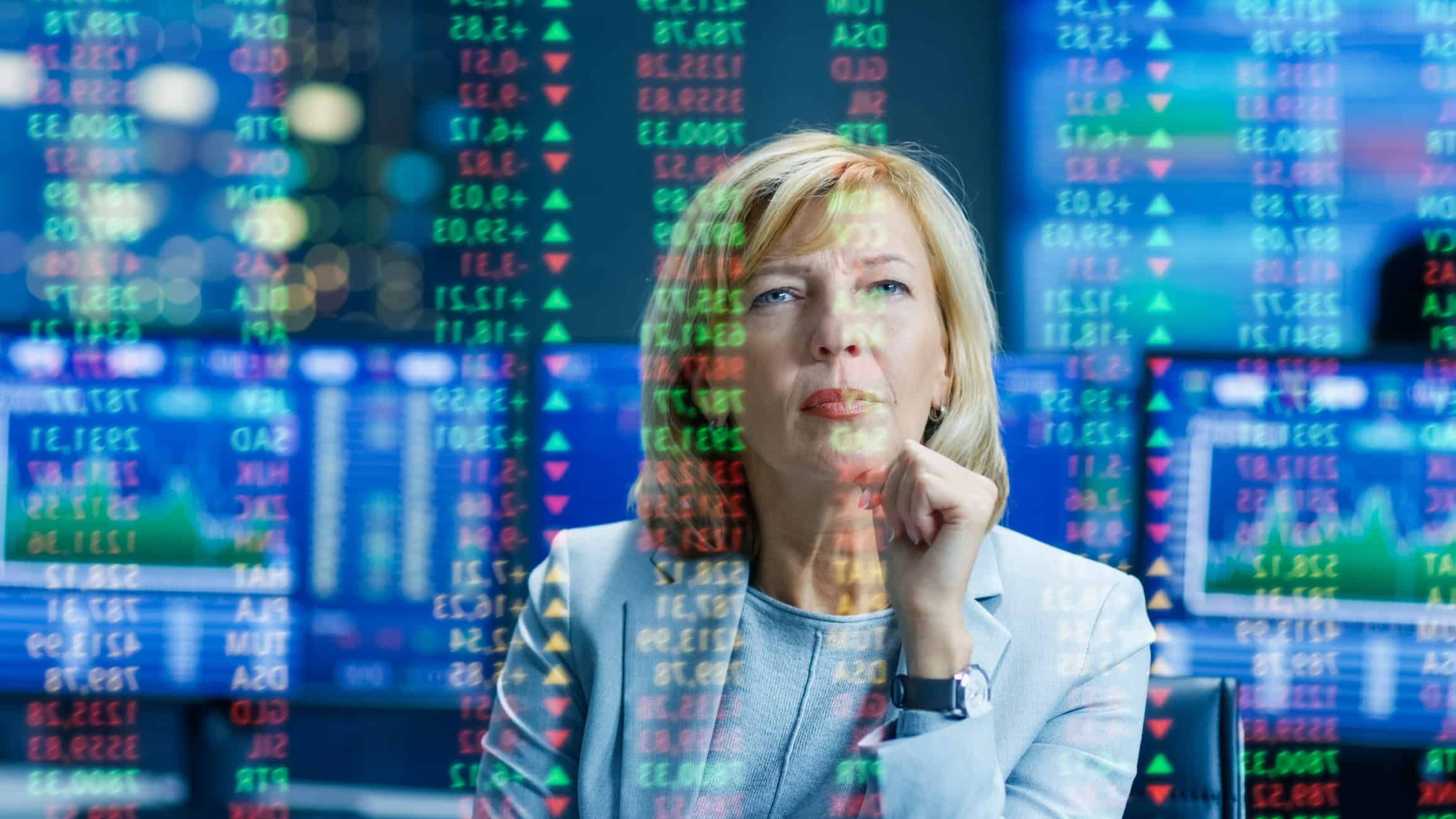 Business woman watching stocks and trends while thinking