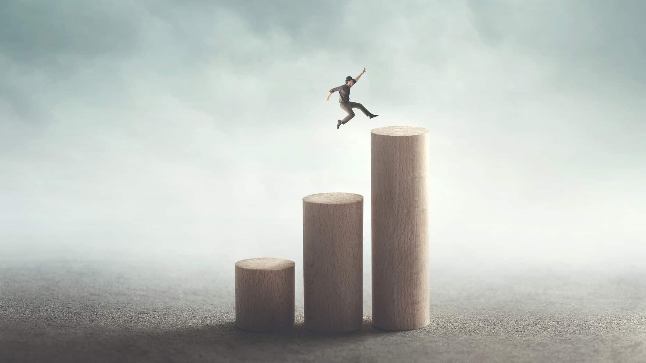 man jumping along increasing bar graph signifying jump in alumina share price