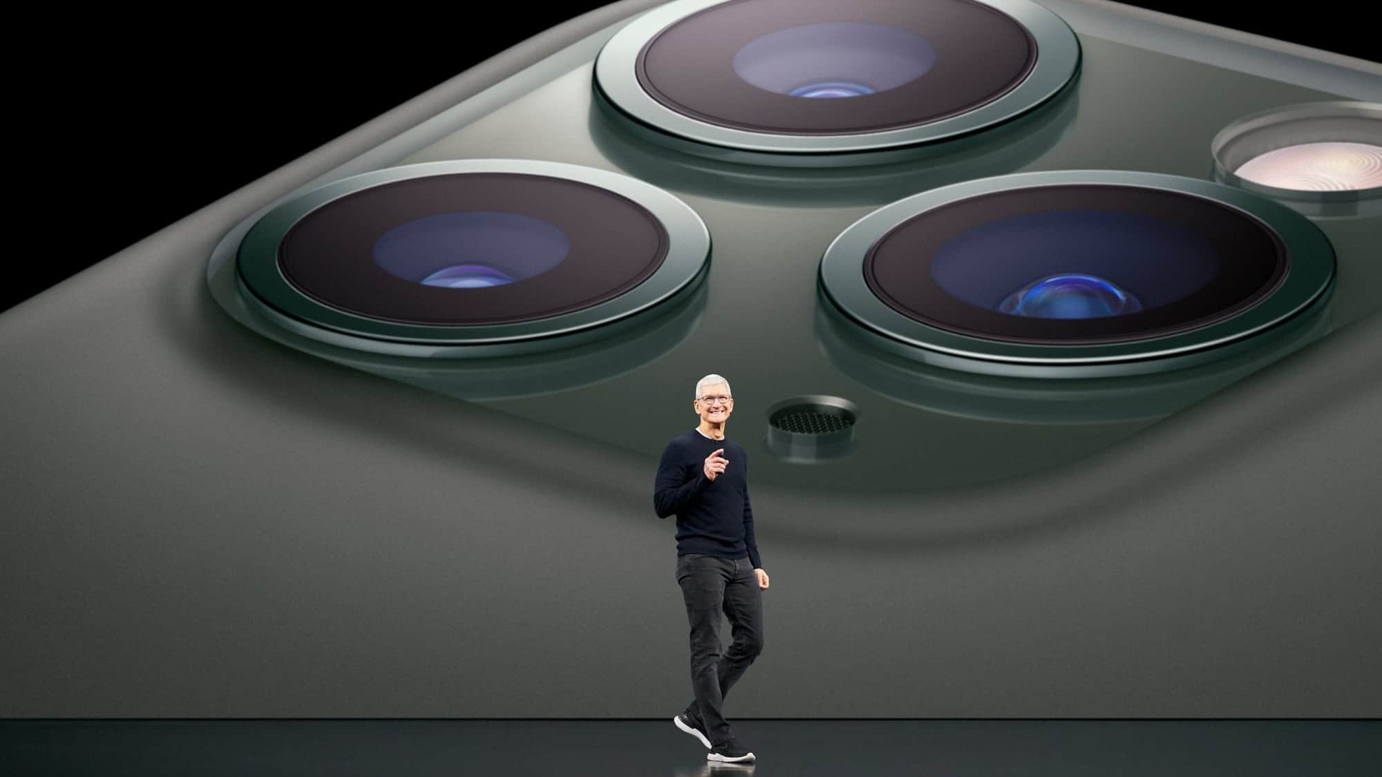 apple stock represented by apple CEO Tim Cook on stage