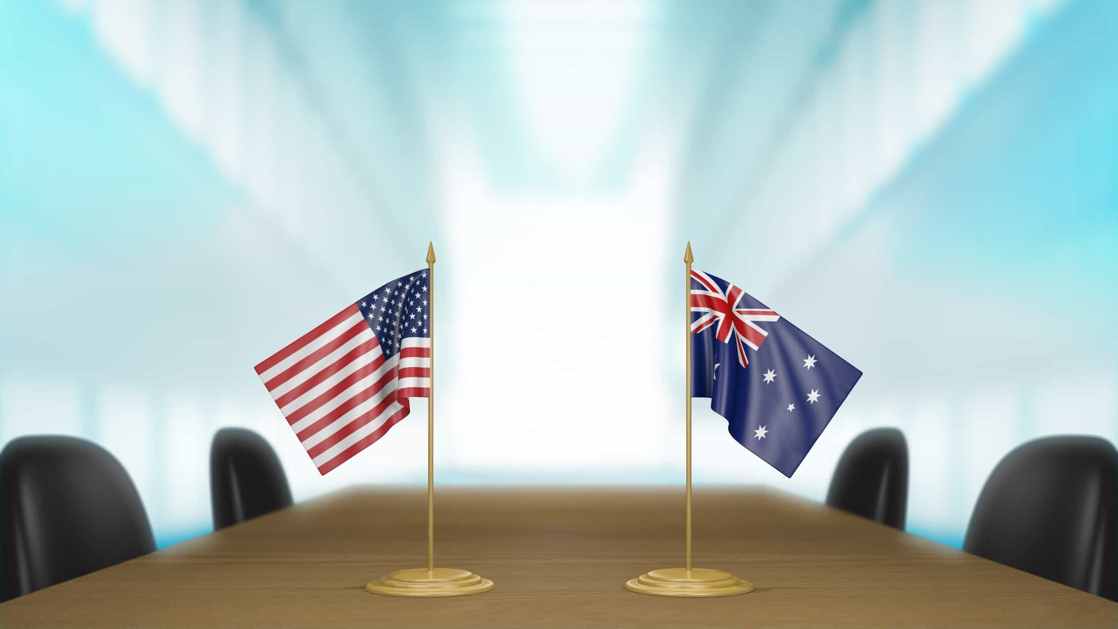 australian and american flags on boardroom table