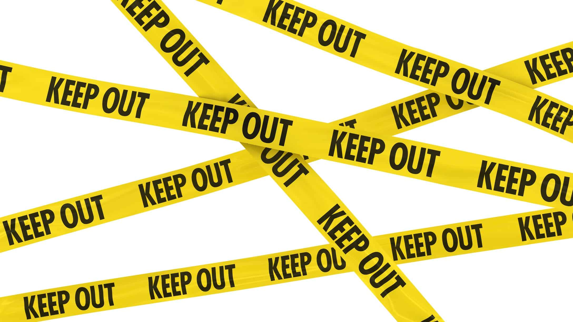 hazard tape stating 'keep out' representing volatility of bank shares