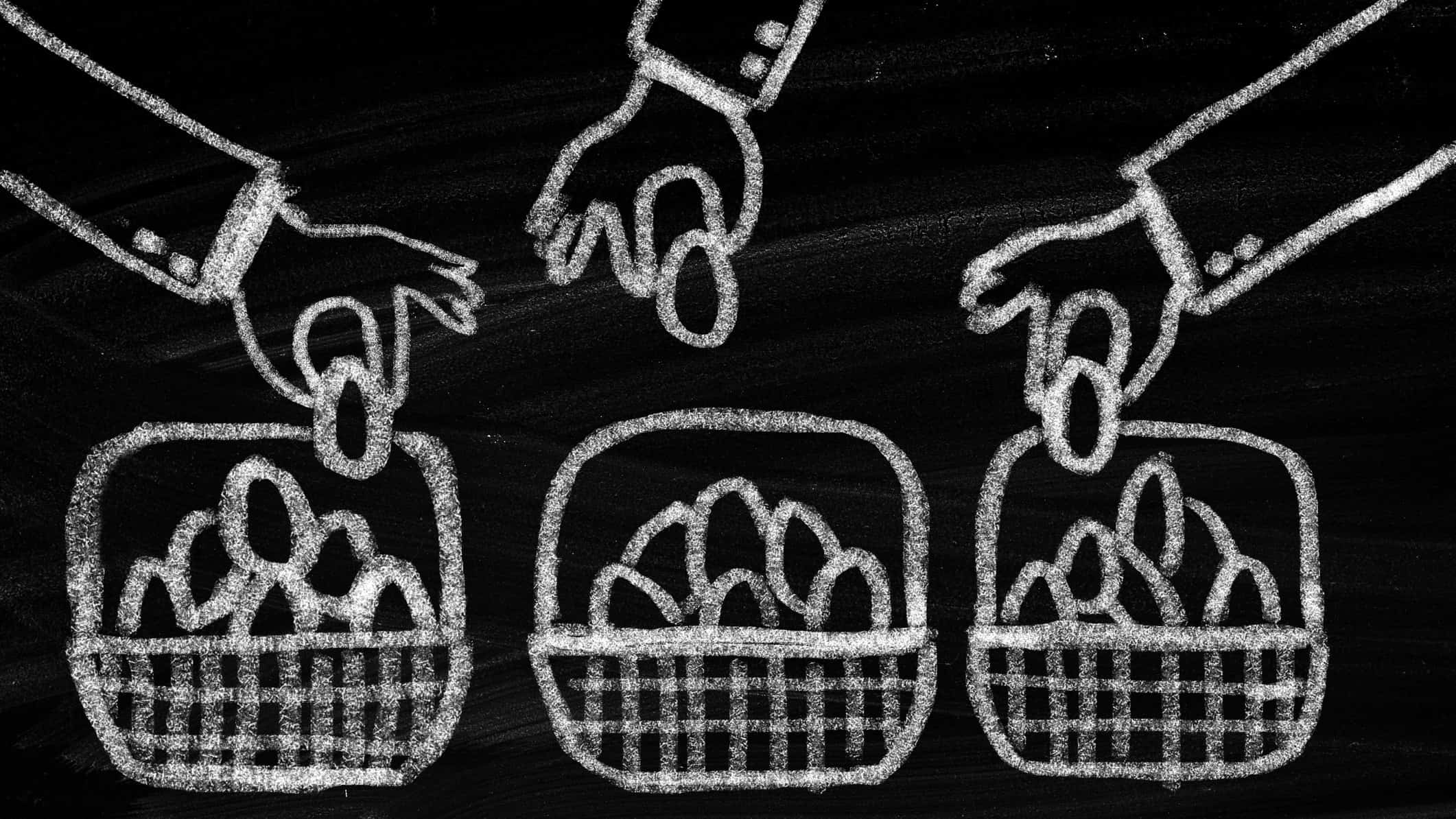 diversification through asx etf represented by chalk drawing of hands placing eggs in multiple baskets