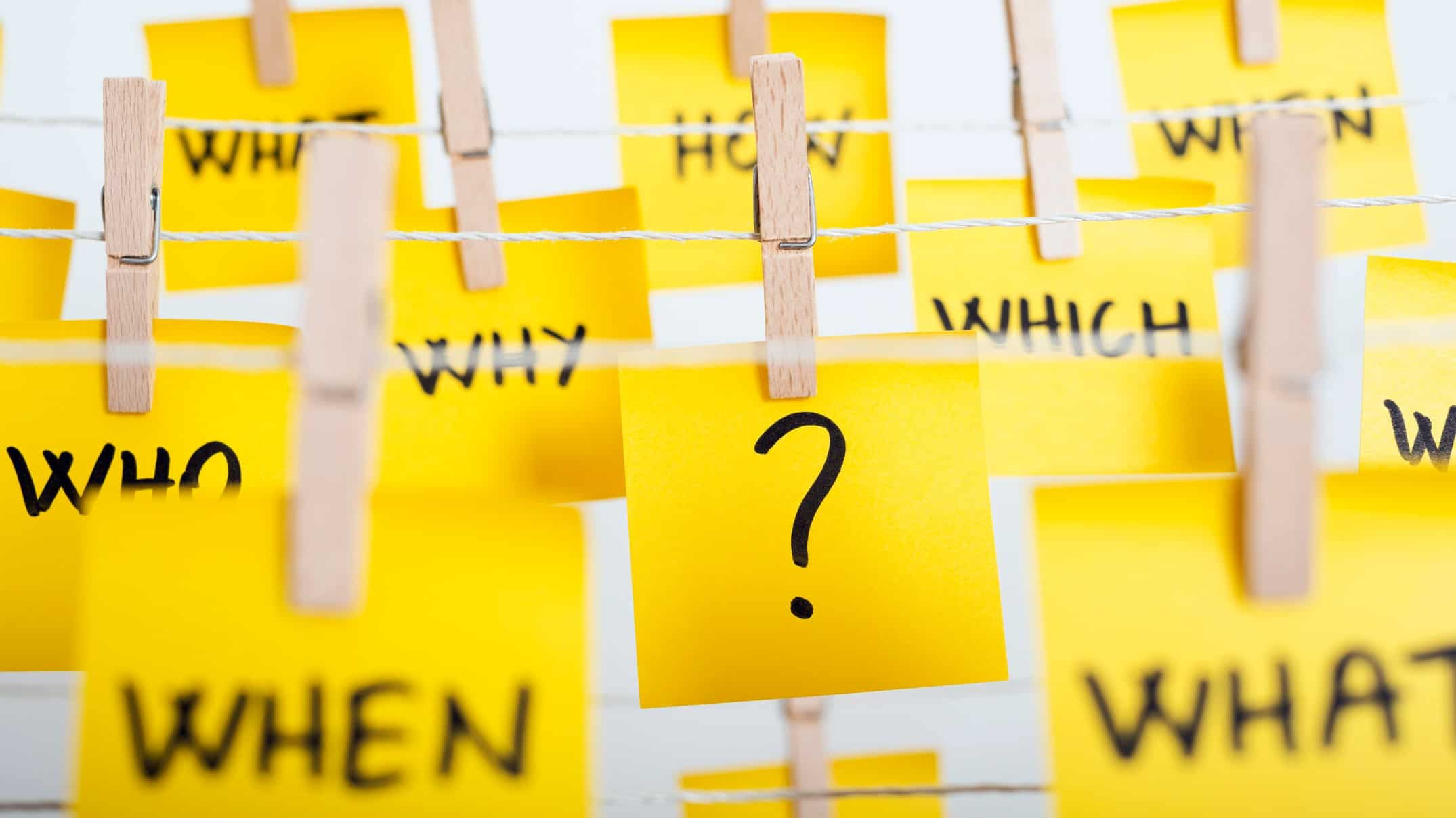 questioning asx share price represented by post it note questions pegged on a line