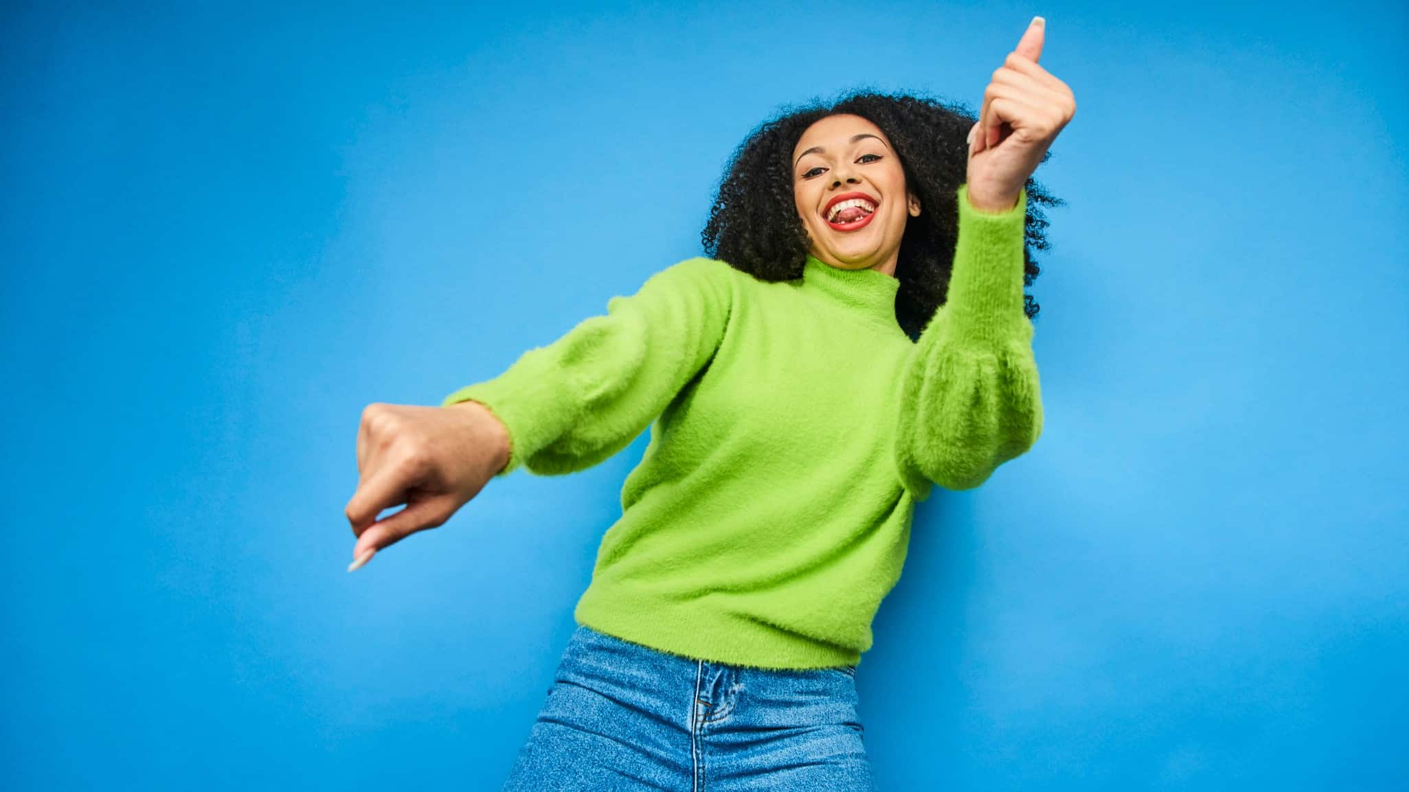 rising asx share price represented by happy woman dancing excitedly