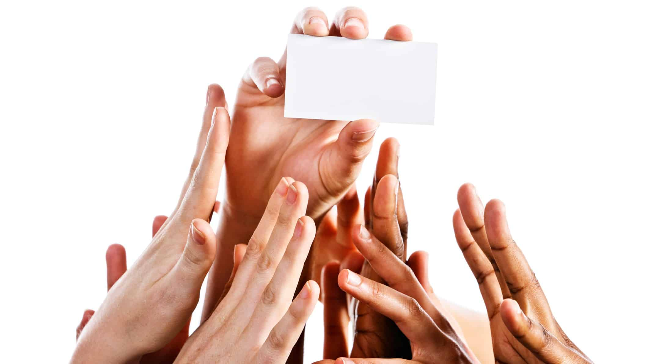 rising fintech share price represented by hands all grabbing at a credit card