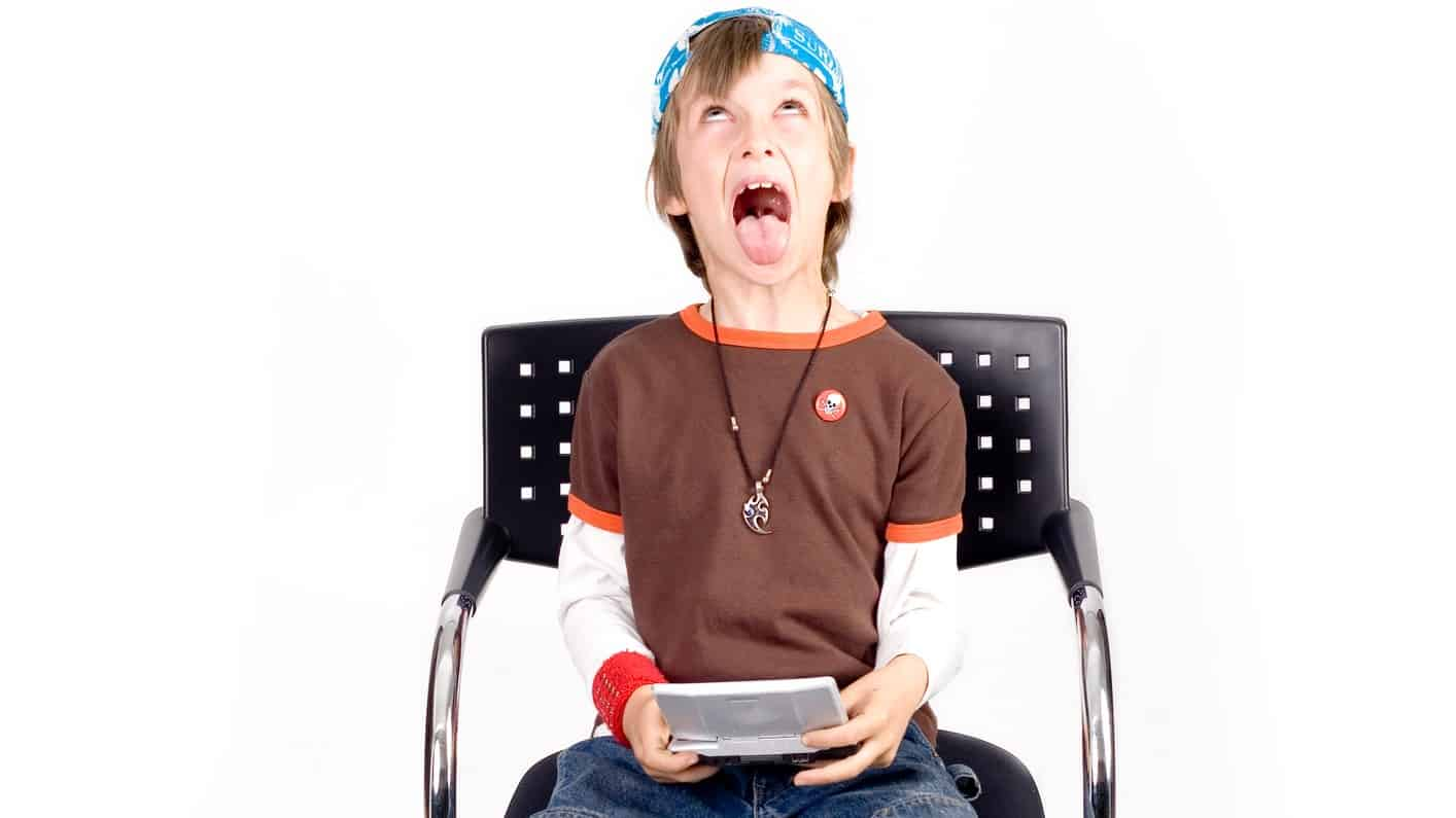 gaming asx share price fall represented by child looking frustrated while playing digital gaming device
