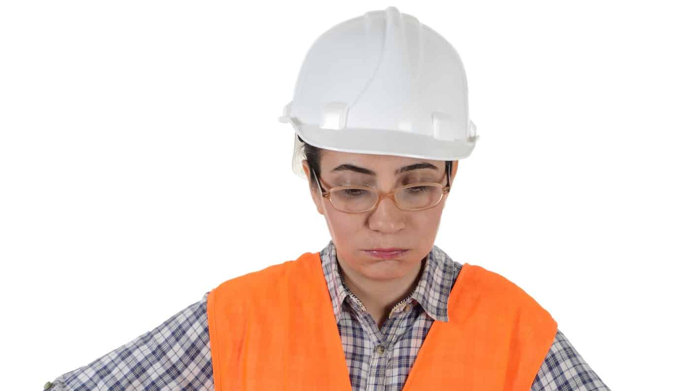 falling mining asx share price represented by sad looking woman in hard hat