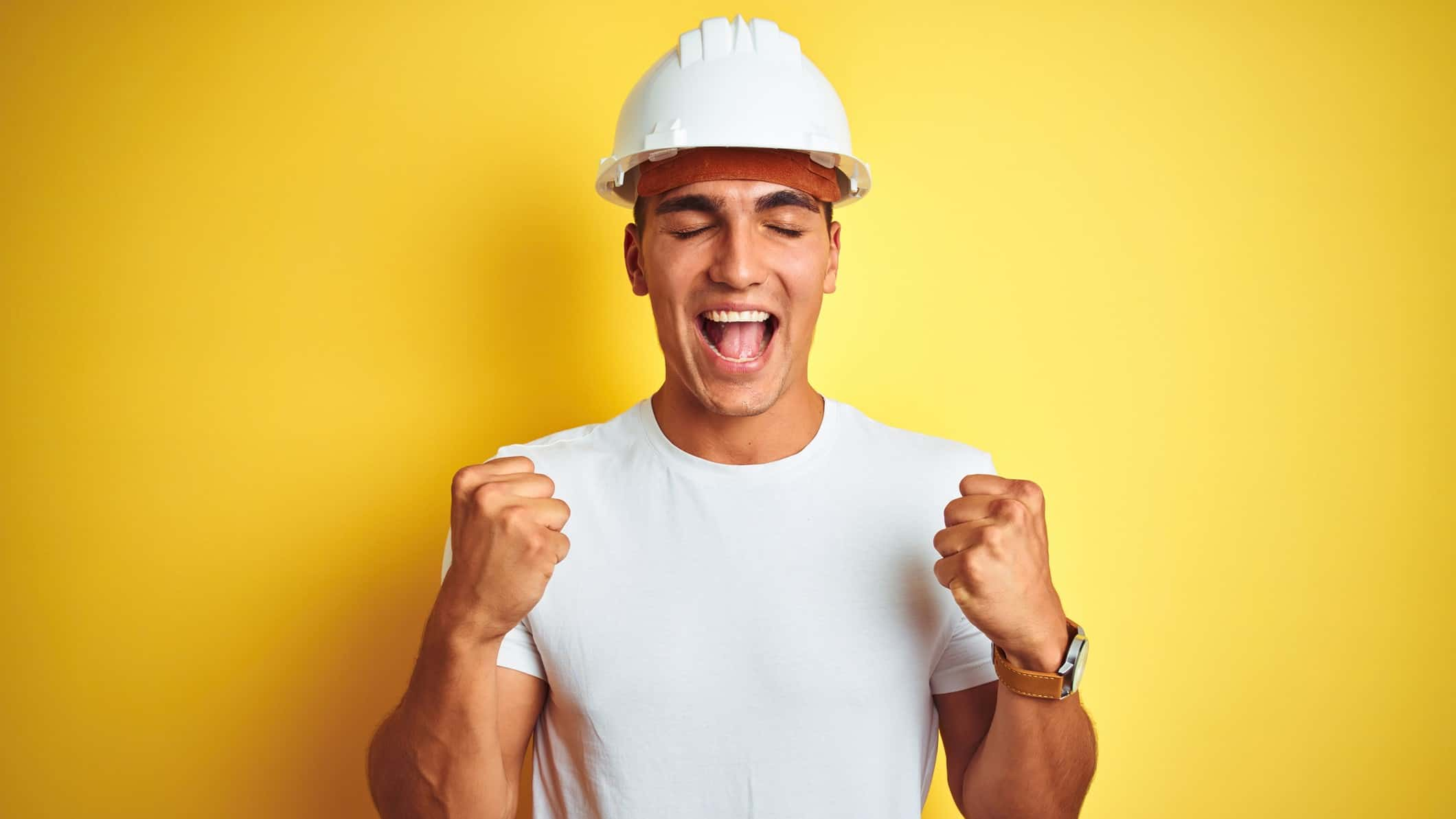 surging asx share price represented by man in hard hat making excited fists