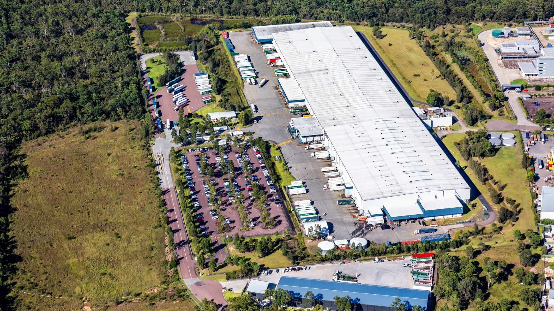 property asx share price represented by aerial view of large warehouse