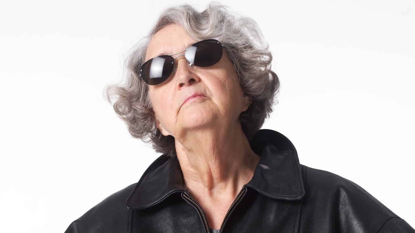 Older woman looking up as if watching asx share price
