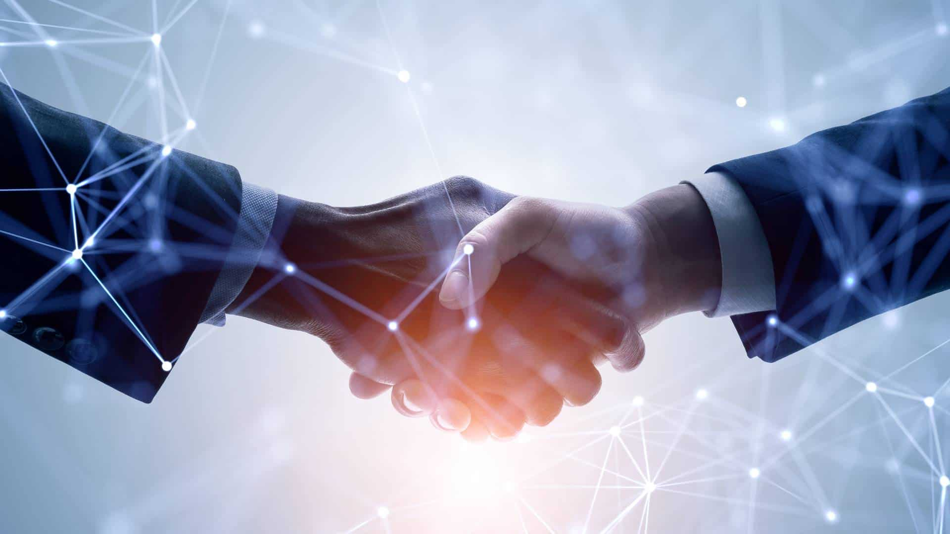 asx share price rising on deal represented by hand shake