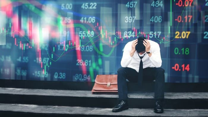 asx share price fall represented by investor with head in hands