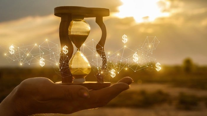 asx share price growth represented by hand holding hourglass surrounded by dollar signs