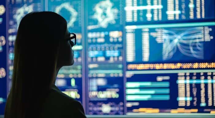 woman watching asx share price on digital screen
