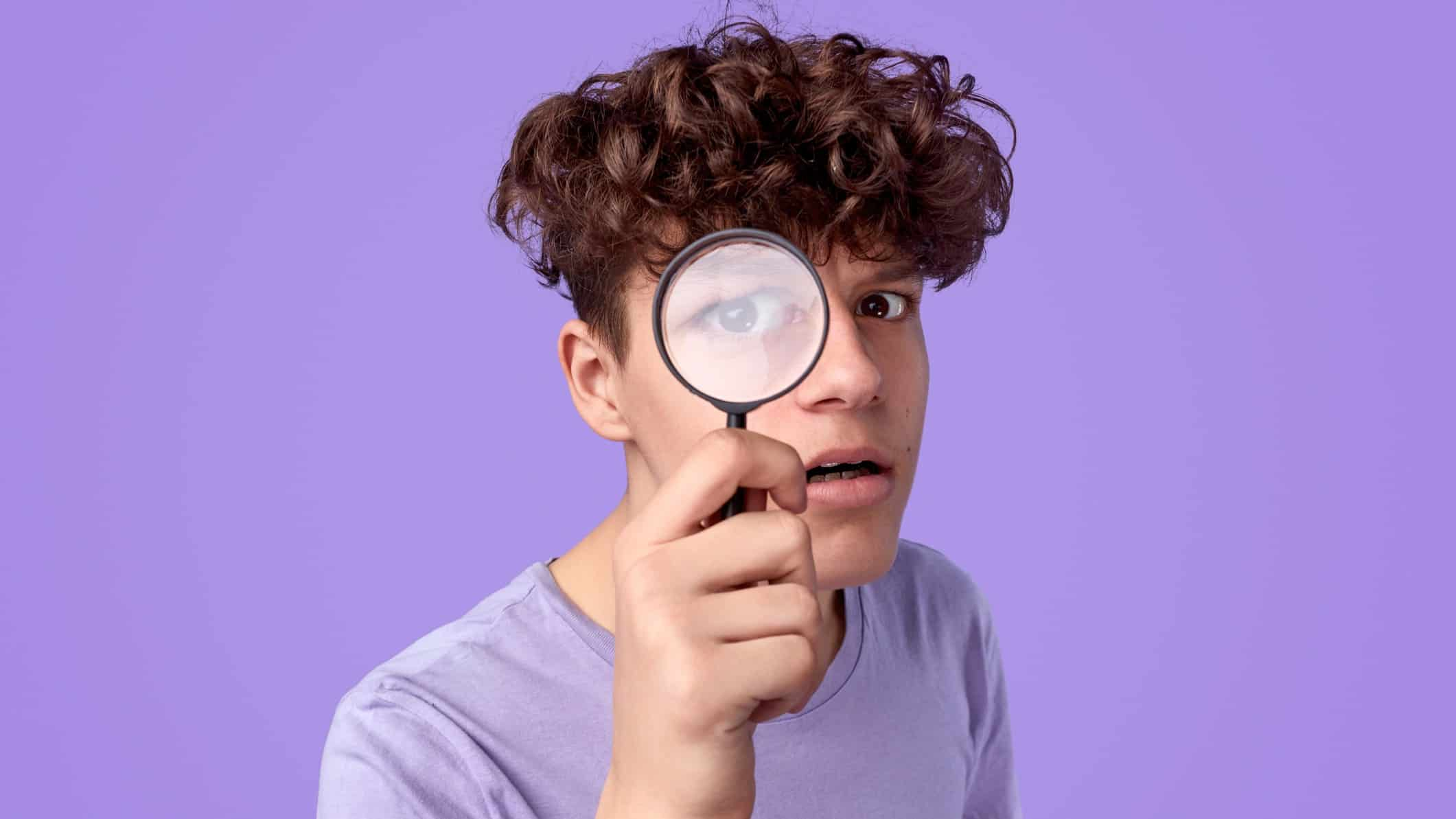 ASX share price on watch represented by man looking through magnifying glass