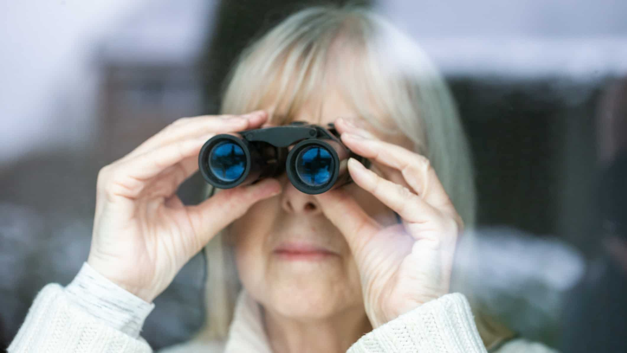 asx share price on watch represented by lady looking through pair of binoculars