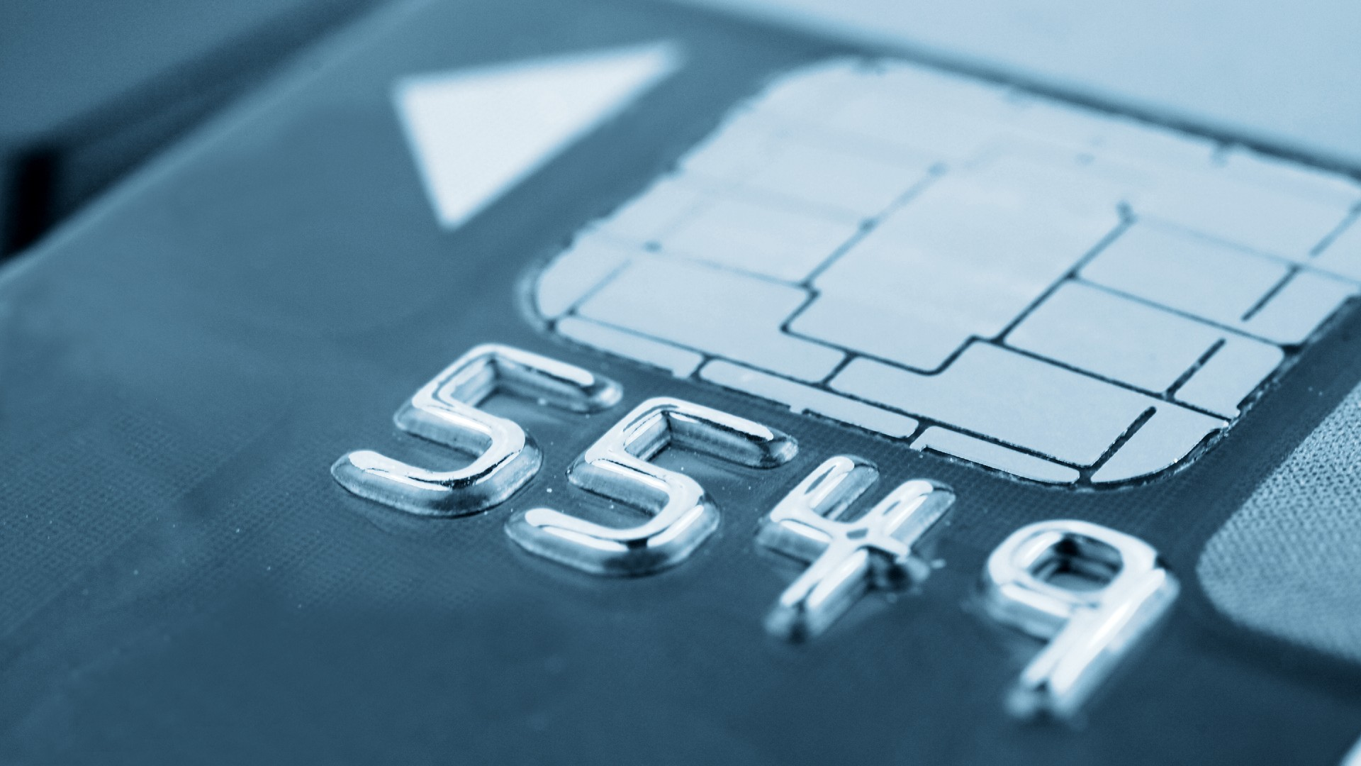 close up of 4 digits on bank card with electronic chip