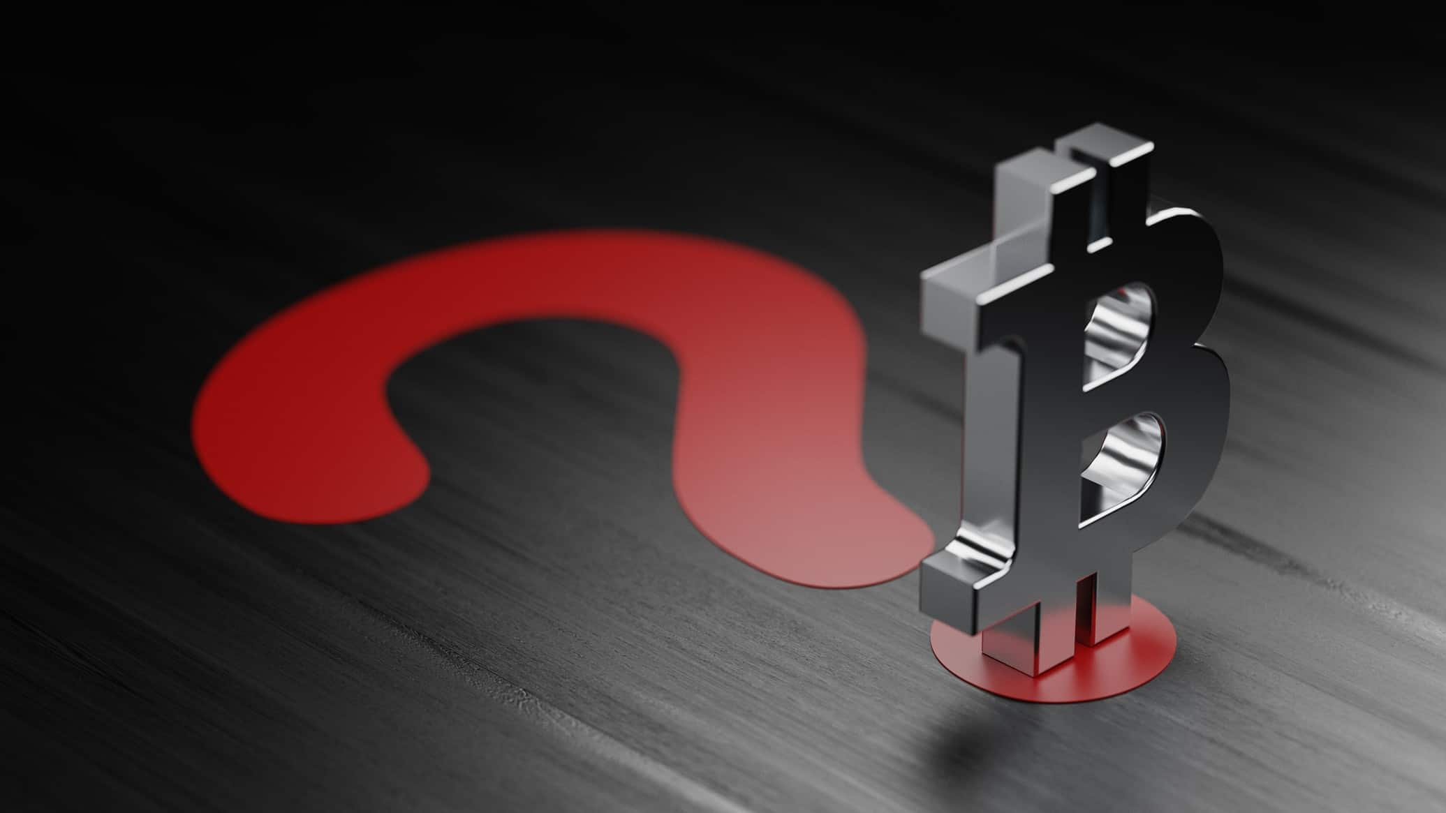 A Bitcoin symbol sits atop a red question mark, indicating uncertainty over the value of crypto currency