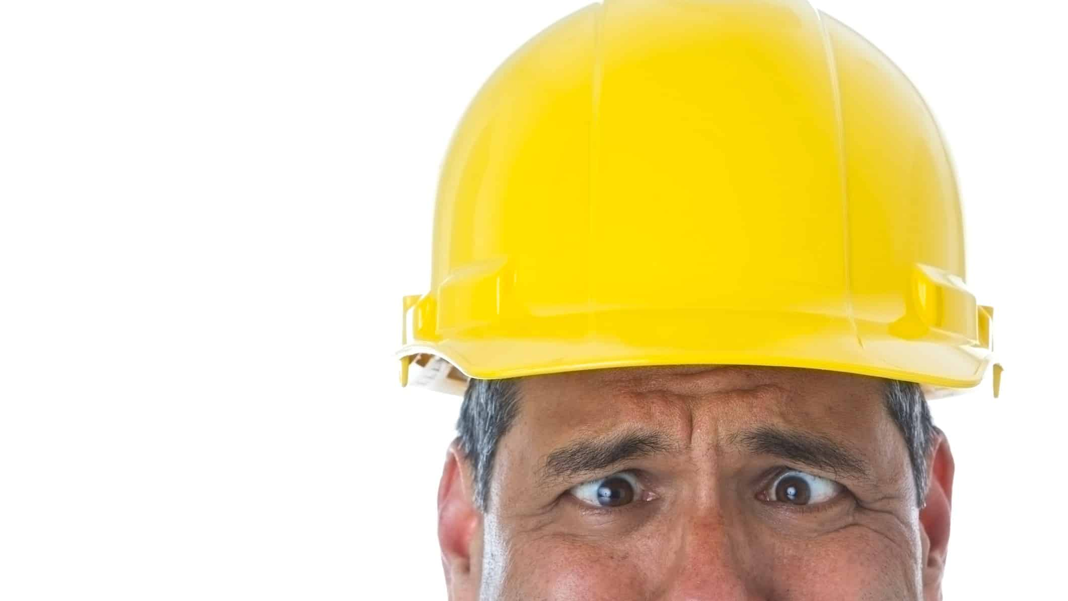 falling asx share price represented by sad looking builder