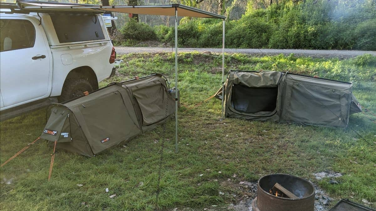 investing and camping analogy represented by camp side next to ute