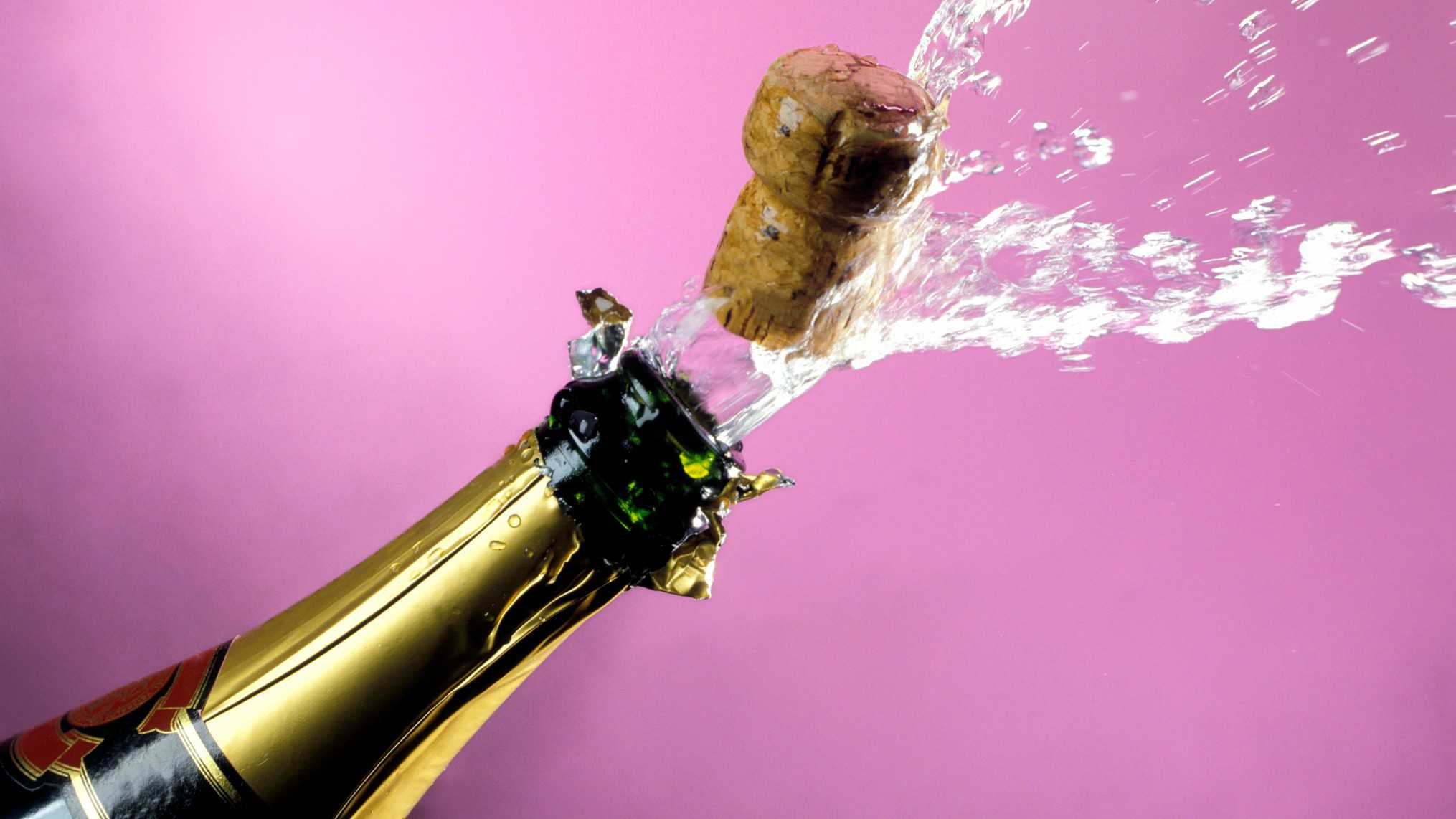 ASX miners iron ore A cork and bubbles burst from champagne bottle, indicating a rising share price in ASX wine companies