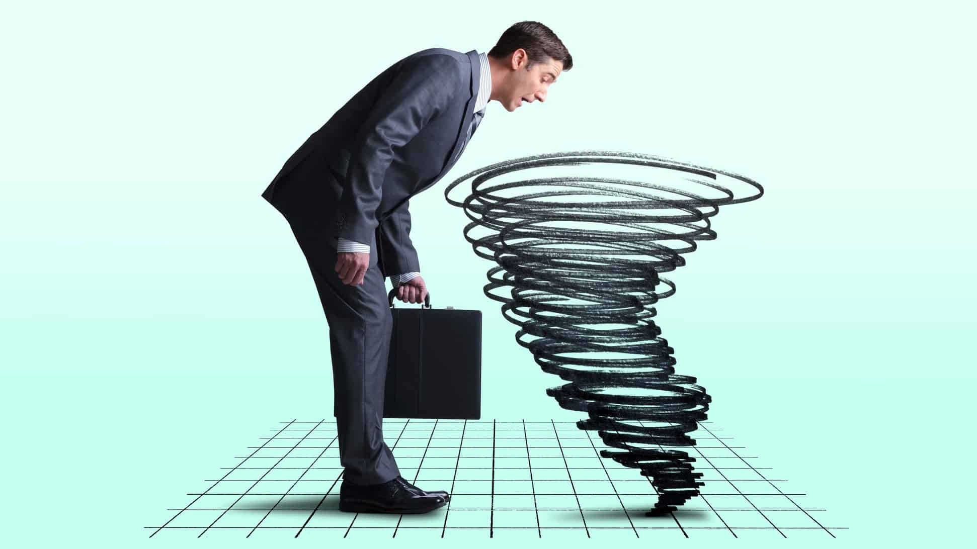 a businessman looks into a graph on the floor as a tornado rises, indicating share market chaos