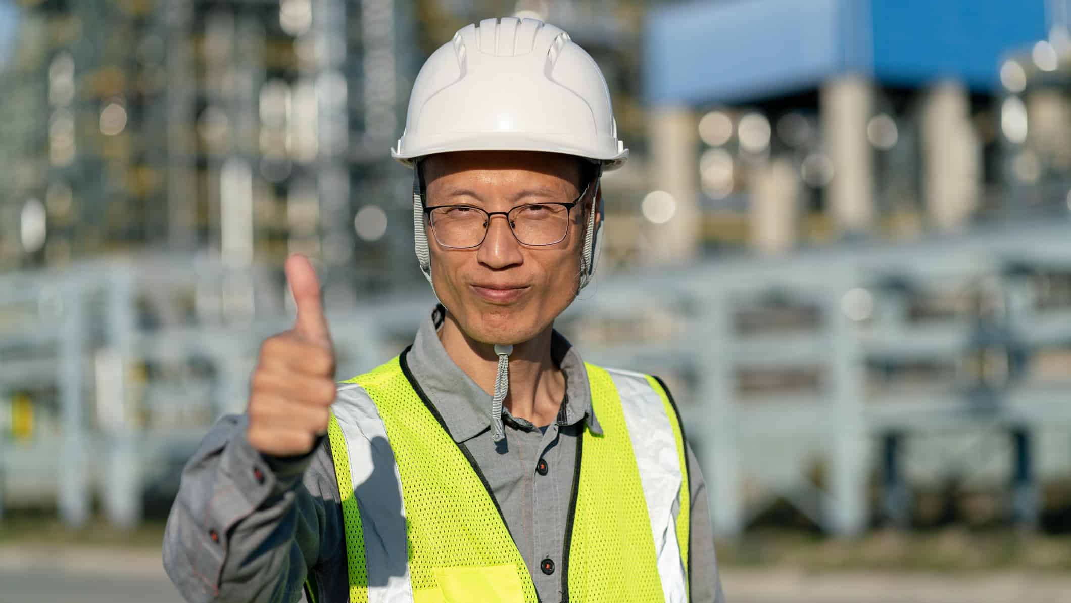 China factory worker giving thumbs up