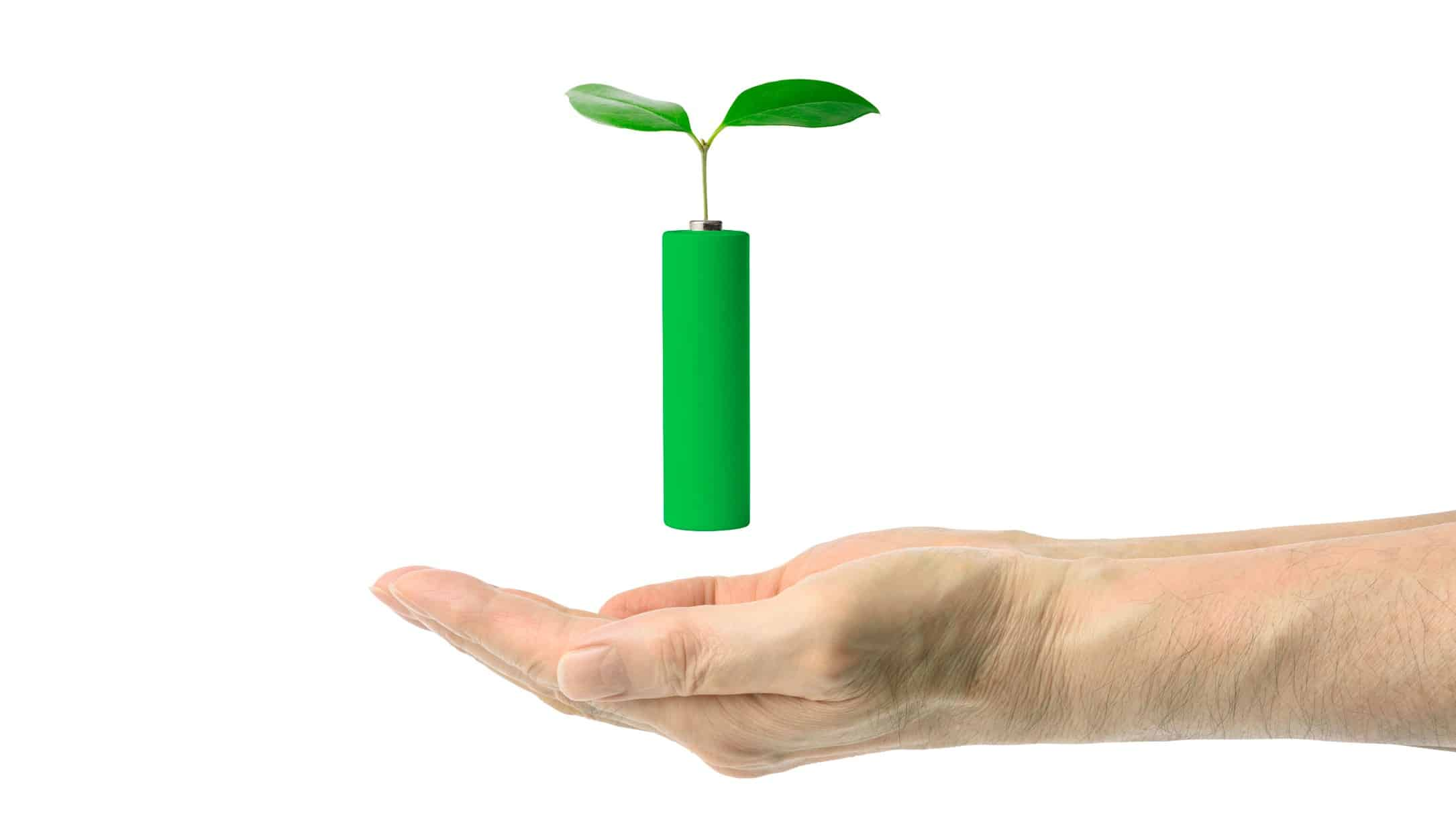 A hand holds a green lithium battery with a leaf, indicating positive share price movement for clean ASX lithium miners