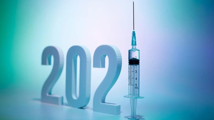 covid vaccine shares represented by numbers 2021 with the one displayed as syringe