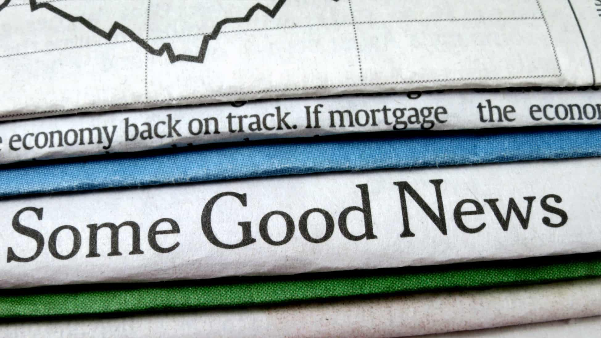 """A newspaper with the words """"Some good news', indicating economic and share price recovery"""